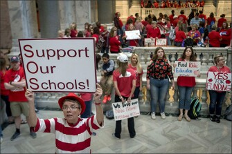 Karen Schwartz, a teacher at Phoenix School of Discovery in Louisville, stands outside the House chambers on April 13 as teachers from across Kentucky gathered outside the state Capitol in Frankfort to rally for increased funding for education.