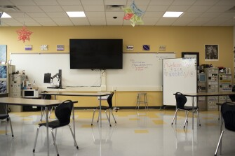 Most classrooms at East High School have large television displays connected to teacher workstations.
